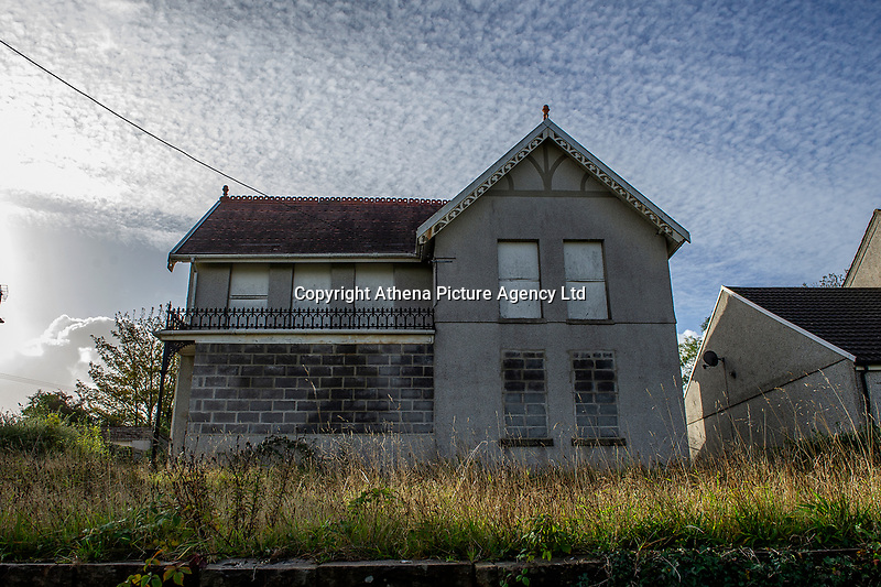 Pictured: The boarded-up house on Gorseinon Road, Penllergaer, Swansea, Wales, UK. Tuesday 08 October 2019 <br /> Re: Why 'eyesore' boarded-up home was sold for more than double the average property price nearby<br /> Nobody had lived in the Penllergaer property for decades before it changed hands for £550,000