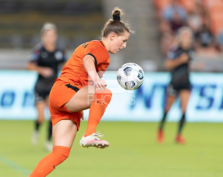 HOUSTON, TX - SEPTEMBER 10: Haley Hanson #9 of the Houston Dash gains control of a loose ball during a game between Chicago Red Stars and Houston Dash at BBVA Stadium on September 10, 2021 in Houston, Texas.
