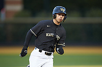 Patrick Frick (5) of the Wake Forest Demon Deacons hustles towards third base against the Illinois Fighting Illini at David F. Couch Ballpark on February 16, 2019 in  Winston-Salem, North Carolina.  The Fighting Illini defeated the Demon Deacons 5-2.  (Brian Westerholt/Four Seam Images)