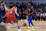 Dennis Smith Jr of Dallas Mavericks (R) in action during the NBA China Games 2018 match between Dallas Mavericks and Philadelphia 76ers at Universiade Center on October 08 2018 in Shenzhen, China. Photo by Marcio Rodrigo Machado / Power Sport Images