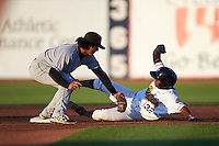 Clinton LumberKings shortstop Chris Mariscal (14) looks to tag Ayendy Perez (32) sliding into second during a game against the Burlington Bees on August 20, 2015 at Community Field in Burlington, Iowa.  Burlington defeated Clinton 3-2.  (Mike Janes/Four Seam Images)