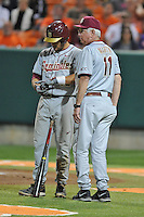 Florida State Seminoles head coach Mike Martin #11 talks with second baseman John Sansone #12 before an at bat during a game against the Clemson Tigers at Doug Kingsmore Stadium on March 22, 2014 in Clemson, South Carolina. The Seminoles defeated the Tigers 4-3. (Tony Farlow/Four Seam Images)