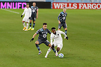 ST PAUL, MN - NOVEMBER 22: Kellyn Acosta #10 of Colorado Rapids and Hassani Dotson #31 of Minnesota United FC battle for the ball during a game between Colorado Rapids and Minnesota United FC at Allianz Field on November 22, 2020 in St Paul, Minnesota.
