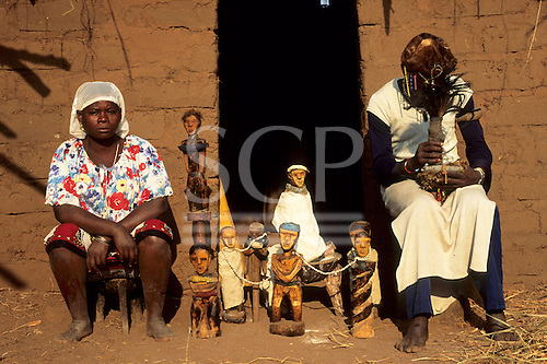 Yumba Bay, Tanzania. Female traditional healers shaman performing a healing ritual with effigies and beads.