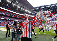 29th May 2021; Wembley Stadium, London, England; English Football League Championship Football, Playoff Final, Brentford FC versus Swansea City; Pontus Jansson of Brentford celebrates with the Sky Bet EFL Championship Plays-off Trophy and their 2-0 win and promotion to the Premier League