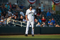 Jacob Gonzalez (18) of the Augusta GreenJackets takes his lead off of third base against the Kannapolis Intimidators at SRG Park on July 6, 2019 in North Augusta, South Carolina. The Intimidators defeated the GreenJackets 9-5. (Brian Westerholt/Four Seam Images)