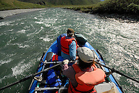 Georgia Bennett rows through a fast stretch of the Kongakut River, with Jonathan Bennett up front, in Alaska's Arctic National Wildlife Refuge.