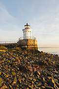 "Portland Breakwater Light in Portland, Maine USA during the spring months. The Portland Breakwater Light is also called the ""Bug Light"" and it is located at the entrance to Portland Harbor. It was designed after a Greek monument."