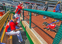 """14 April 2013: Jordan Zimmermann and Stephen Strasburg watch the dogs and their owners from the region take part in the pre-game """"Pup Parade"""" as a part of the """"Pups in the Park"""" celebration at a game between the Atlanta Braves and the Washington Nationals at Nationals Park in Washington, DC. The Braves shut out the Nationals 9-0 to sweep their 3-game series. Mandatory Credit: Ed Wolfstein Photo *** RAW (NEF) Image File Available ***"""