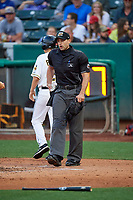 Umpire Alex Mackay handles the calls behind the plate during the game between the Salt Lake Bees and the Oklahoma City Dodgers at Smith's Ballpark on July 31, 2019 in Salt Lake City, Utah. The Dodgers defeated the Bees 5-3. (Stephen Smith/Four Seam Images)
