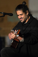 """Mannarino (Alessandro Mannarino Singer, Songwriter, Musician).<br /> <br /> Rome, 19/12/2020. Today, the Nuovo Cinema Palazzo Community held a third public assembly (1.) in Rome's San Lorenzo district to protest against the eviction of the """"Nuovo Cinema Palazzo"""" completed by the Italian police forces in the early morning of the 25th of November and to demonstrate against the violent reaction of the Police forces when, in the evening of the same day, a large demo asked to have the chance to hold a public assembly in the square (Piazza dei Sanniti) of the cinema (2.). The public assembly of today saw the participation, performances, support & solidarity of the representatives of movements, actors, musicians, poets, students, artists, and citizens of San Lorenzo who told their stories and memories related to the famous Rome's Art and culture occupation.<br /> The Nuovo Cinema Palazzo was occupied the 15th of April 2011, when citizens, movements, workers of the entertainment industry reopened the former """"Palazzo Cinema"""" to prevent the opening of a casino/gambling space. The illegal occupation was intended as a public hub of art, culture, sport and politics, an open place for exchange, discussion, studies, caring and sharing.<br /> <br /> Footnotes & Links:<br /> 1. http://bit.do/fL2Vu<br /> 2. 25.11.2020 - Demo And Clashes Against Nuovo Cinema Palazzo Eviction in Rome's San Lorenzo: http://bit.do/fLxgz<br /> Previous Public Assemblies: http://bit.do/fLCr3 & http://bit.do/fL2VR & http://bit.do/fL2Y5<br /> Videos of the Event: http://bit.do/fL2Wc & http://bit.do/fL2V6"""