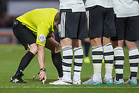 The Referee uses the spray foam to mark during the Capital One Cup match between Wycombe Wanderers and Fulham at Adams Park, High Wycombe, England on 11 August 2015. Photo by Andy Rowland.