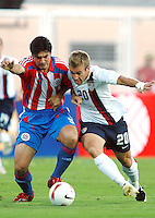 Taylor Twellman battles for the ball during the Copa America 2007 in Barinas Venezuela on July 2, 2007.  USA 1, Paraguay 3.