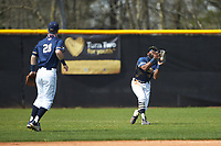 Queens Royals left fielder Noah Jones (26) catches a fly ball during the game against the Catawba Indians during game one of a double-header at Tuckaseegee Dream Fields on March 26, 2021 in Kannapolis, North Carolina. (Brian Westerholt/Four Seam Images)