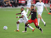 WASHINGTON, DC - AUGUST 25: Ola Kamara #9 of D.C. United battles for the ball with Andrew Farrell #2 of New England Revolution during a game between New England Revolution and D.C. United at Audi Field on August 25, 2020 in Washington, DC.