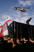"""Tehran, Iran .June 7, 1989..Hundreds of mourners visit and touch the tomb of the Grand Ayatullah Sayid Ruhullah Musawi Khomeini in the Beheht-E-Zahra cemetery the morning following his funeral. Flowers are dropped by helicopters from above and women have soldiers guarding the tomb, touch their babies to it's walls as a blessing. He died of heart attack on June 3, 1989...Khomeini was a senior Shi`i Muslim cleric, Islamic philosopher and marja (religious authority), and the political leader of the 1979 Iranian Revolution that saw the overthrow of Mohammad Reza Pahlavi, the last Shah of Iran. Following the revolution, Khomeini became the country's Supreme Leader?the paramount political figure of the new Islamic Republic...Khomeini was a marja al-taqlid, (source of imitation) and important spiritual leader to many Shia Muslims. He was also an innovative Islamic political theorist, most noted for his development of the theory of velayat-e faqih, the """"guardianship of the jurisconsult (clerical authority)"""". He was named Time's Man of the Year in 1979 and also one of Time magazine's 100 most influential people of the 20th century."""