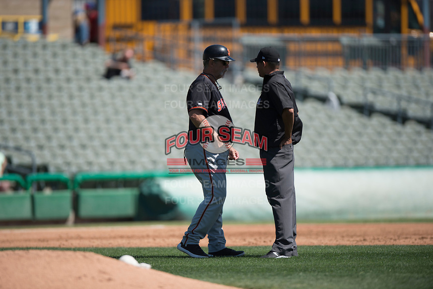 San Jose Giants manager Bill Hayes (51) discusses a call with field umpire Gabriel Alfonzo during a California League game against the Stockton Ports on April 9, 2019 in Stockton, California. San Jose defeated Stockton 4-3. (Zachary Lucy/Four Seam Images)