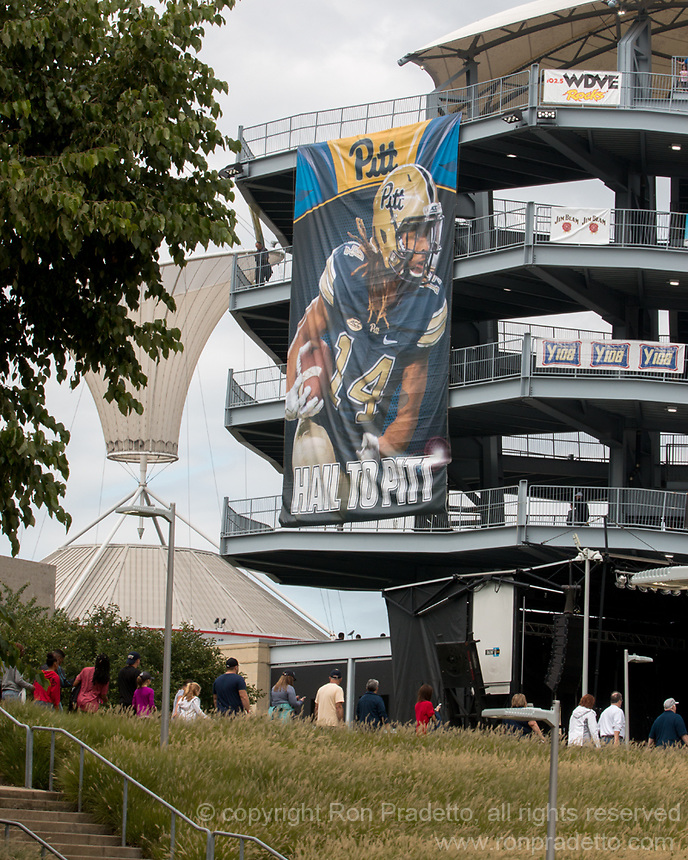 This football banner hanging over Heinz Field is of defensive back Avonte Maddox. Ron Pradetto Photography took the photo that was used in the banner. The Pitt Panthers defeated the Youngstown State Penguins 28-21 in overtime at Heinz Field, Pittsburgh, Pennsylvania on September 02, 2017.