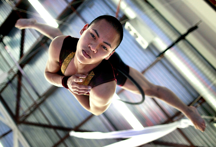 """Mo-Nika Ell, a 2008 ACMA grad, rehearses his routine on the aerial bars last Sunday for Pendulum Dance Theatre's production """"NINE: An Evening of Unconfined Circus"""" which is being held May 2nd and 3rd at the French American International School."""