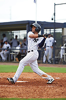 GCL Yankees East center fielder Robert Javier (19) follows through on a swing during the first game of a doubleheader against the GCL Yankees West on July 19, 2017 at the Yankees Minor League Complex in Tampa, Florida.  GCL Yankees West defeated the GCL Yankees East 11-2.  (Mike Janes/Four Seam Images)