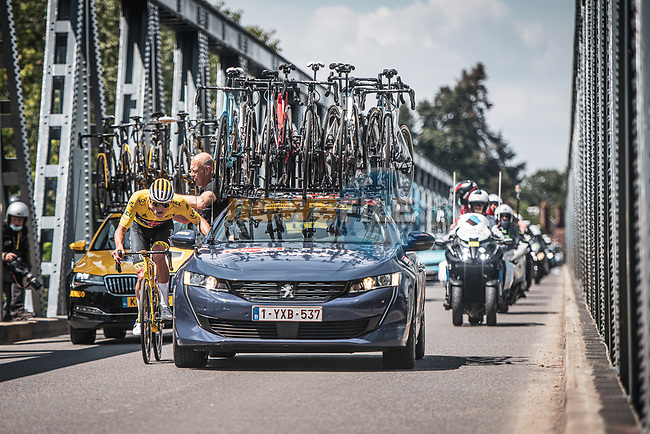 Race leader Yellow Jersey Mathieu Van Der Poel (NED) Alpecin-Fenix recieves attention from his team car during Stage 7 of the 2021 Tour de France, running 249.1km from Vierzon to Le Creusot, France. 2nd July 2021.  <br /> Picture: A.S.O./Charly Lopez | Cyclefile<br /> <br /> All photos usage must carry mandatory copyright credit (© Cyclefile | A.S.O./Charly Lopez)