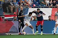 FOXOBOROUGH, MA - AUGUST 21: Jaap Stamp Head Coach of of FC Cincinnati watches Yuya Kubo #7 of FC Cincinnati control the ball as Gustavo Bou #7 of New England Revolution comes in to tackle during a game between FC Cincinnati and New England Revolution at Gillette Stadium on August 21, 2021 in Foxoborough, Massachusetts.