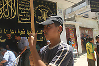 "Palestinian boy attend funeal of  Hesham al-Jamal, an Islamic Jihad militant who was killed by an Israeli air strike, during his funeral in the southern Gaza Strip August 5, 2007. An Israeli air strike on two vehicles killed two Palestinian militants in the southern Gaza Strip on Saturday, ambulance crews and local residents said.""photo by Fady Adwan"""