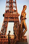 Golden statues of Palais de Chaillot with Eiffel Tower in the background. City of Paris. Paris. France