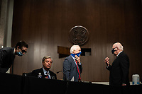 United States Senator John Cornyn (Republican of Texas), right center, talks with US Senator Patrick Leahy (Democrat of Vermont), right, as US Senator Lindsey Graham (Republican of South  Carolina), Chairman, US Senate Judiciary Committee, center left, speaks with an unidentified aide at a US Senate Judiciary Committee business meeting to consider authorization for subpoenas relating to the Crossfire Hurricane investigation and other matters on Capitol Hill in Washington, DC on June 11, 2020. (Erin Schaff/The New York Times)<br /> Credit: Erin Schaff / Pool via CNP/AdMedia