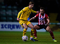 Lincoln City's Neal Eardley vies for possession with Milton Keynes Dons' Alex Gilbey<br /> <br /> Photographer Andrew Vaughan/CameraSport<br /> <br /> The EFL Sky Bet League One - Lincoln City v Milton Keynes Dons - Tuesday 11th February 2020 - LNER Stadium - Lincoln<br /> <br /> World Copyright © 2020 CameraSport. All rights reserved. 43 Linden Ave. Countesthorpe. Leicester. England. LE8 5PG - Tel: +44 (0) 116 277 4147 - admin@camerasport.com - www.camerasport.com