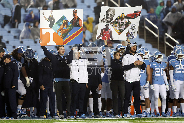 CHAPEL HILL, NC - NOVEMBER 23: Play calling cards on the University of North Carolina sideline during a game between Mercer University and University of North Carolina at Kenan Memorial Stadium on November 23, 2019 in Chapel Hill, North Carolina.