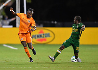 LAKE BUENA VISTA, FL - JULY 18: Alberth Elis #7 of the Houston Dynamo has his pass blocked by Diego Chará #21 of the Portland Timbers during a game between Houston Dynamo and Portland Timbers at ESPN Wide World of Sports on July 18, 2020 in Lake Buena Vista, Florida.