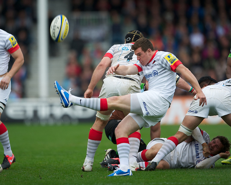 Ben Spencer of Saracens sends up a box kick during the Aviva Premiership match between Harlequins and Saracens at the Twickenham Stoop on Sunday 30th September 2012 (Photo by Rob Munro)