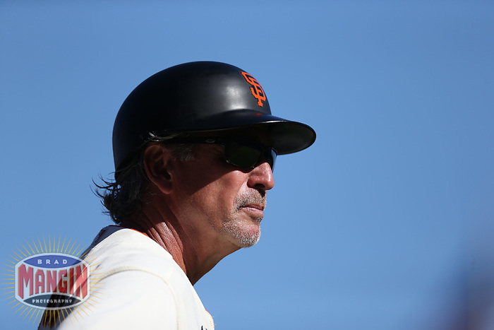 SAN FRANCISCO, CA - SEPTEMBER 19:  Third base coach Ron Wotus #23 of the San Francisco Giants works during the game against the Atlanta Braves at Oracle Park on Sunday, September 19, 2021 in San Francisco, California. (Photo by Brad Mangin)