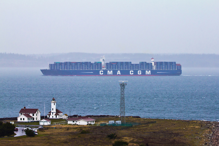 CMA CGM Benjamin Franklin, Explorer class container ship, French shipping line, largest container ship on US West coast, out bound from Seattle, Puget Sound, passing Point Wilson, Port Townsend, Washington State,