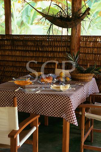 Tataquara, Amazon, Brazil. Ecotourism tourist lodge hotel; table in restaurant set for breakfast; Tataquara, Xingu river.