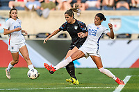 BRIDGEVIEW, IL - JULY 18: Katie Johnson #33 of the Chicago Red Stars and Alana Cook #4 of the OL Reign battle for the ball during a game between OL Reign and Chicago Red Stars at SeatGeek Stadium on July 18, 2021 in Bridgeview, Illinois.
