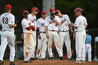 Ball State Cardinals head coach Rich Maloney (2) makes a pitching change to Devin Wilburn (43) as Elbert Devarie, Alex Maloney, Ryan Spaulding, David Current, Sean Kennedy and Jarett Rindfleisch (L-R) look on during a game against the Maine Black Bears on March 3, 2015 at North Charlotte Regional Park in Port Charlotte, Florida.  Ball State defeated Maine 8-7.  (Mike Janes/Four Seam Images)
