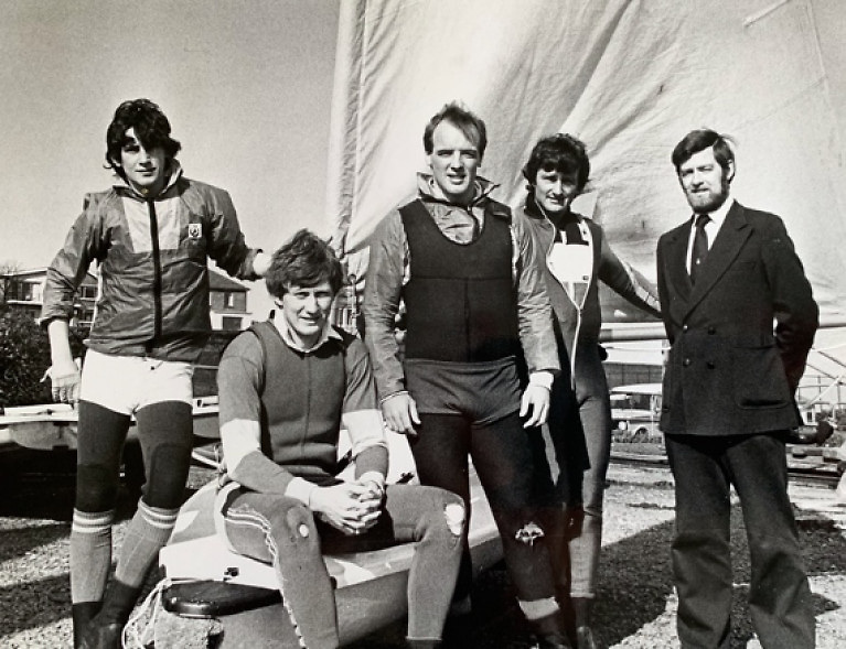"""""""Warriors About to Go into Battle"""". This properly serious-looking foursome from the cream of the 1982 Irish Laser Class, with their mentor Ron Huthcieson on right, are (left to right) Simon Brien (later multiple Edinburgh Cup winner and other majors), multiple champion Charlie Taylor (still at it in the Laser Masters), Olympian Bill O'Hara, and Dave Cummins, All-Ireland Helmsmans Champion 1981 and 1982 Credit: courtesy Bill O'Hara"""