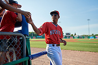 Batavia Muckdogs Brayan Hernandez (23) signs autographs for young fans before a NY-Penn League game against the State College Spikes on July 3, 2019 at Dwyer Stadium in Batavia, New York.  State College defeated Batavia 6-4.  (Mike Janes/Four Seam Images)