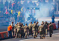 Oct 20, 2019; Ennis, TX, USA; US Army soldiers look on as NHRA top fuel driver Jordan Vandergriff does a burnout during the Fall Nationals at the Texas Motorplex. Mandatory Credit: Mark J. Rebilas-USA TODAY Sports