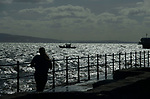 Swansea, UK, 11th May 2020.<br />People exercising on the seafront in Mumbles, Swansea this morning during the cold easterly gales.  The devolved Welsh government continue to ask people in Wales to stay at home due to the Coronavirus pandemic.