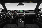 Stock photo of straight dashboard view of 2018 BMW 3 Series 330i GT M Sport 5 Door Hatchback