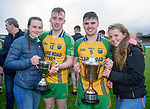 Michelle Mescall and Caitlin Mc Inerney of the U-16 A victorious camogie team who won their county final earlier on the day, celebrate with their brothers Dave Mescall and Cian Mc Inerney  following the Minor A county final win over Kilmaley at Cusack Park. Photograph by John Kelly.
