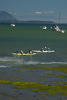 Kayakers off Sucia Island, San Juan Islands, Washington, US