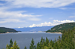 """Scenic Lake Koocanusa lies north of Libby, Montana and is formed by Libby Dam, blocking the Kootenai River and forming a resevoir nearly four hundred feet deep and fourty-eight miles long.  Scenic drives encircle the lake crossing over at the """"long bridge"""", Montana's longest span."""