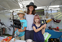 Pictured: Sarah Wygas (C) with son Henry and daughter Martha at Puppet Soup (3rd L) Saturday 13 August 2016<br />