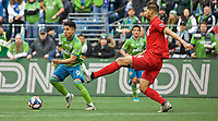 SEATTLE, WA - NOVEMBER 10: Seattle Sounders forward Raul Ruidiaz #9 dribbles around Toronto FC defender Omar Gonzalez #44 during a game between Toronto FC and Seattle Sounders FC at CenturyLink Field on November 10, 2019 in Seattle, Washington.