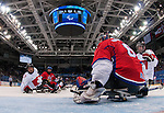 Sochi, RUSSIA - Mar 11 2014 -  Brad Bowden looks on as Czech goalie Michal Vapenka covers the puck as Canada takes on Czech Republic in Sledge Hockey at the 2014 Paralympic Winter Games in Sochi, Russia.  (Photo: Matthew Murnaghan/Canadian Paralympic Committee)