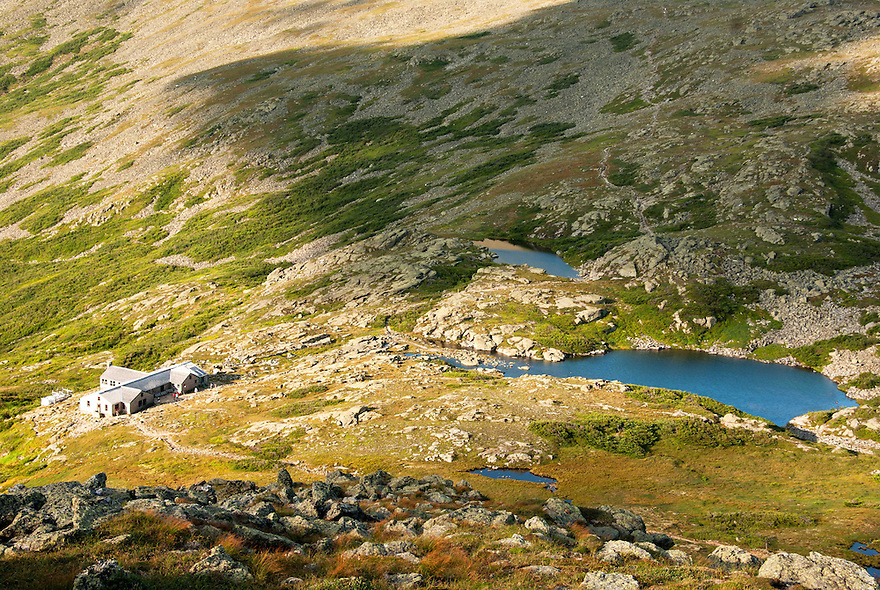 A look down at the Lakes of the Clouds and the AMC hut of the same name on a blue sky summer day.